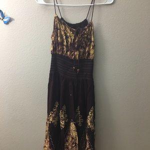 Dark maroon gown .